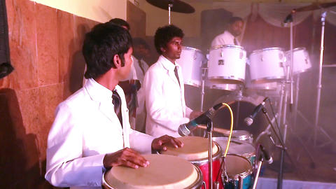 Musician playing percussion drums with his hands. Close-up Footage