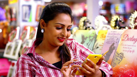 Girl using mobile phone - Smart phone, Attractive young woman using a smart Footage
