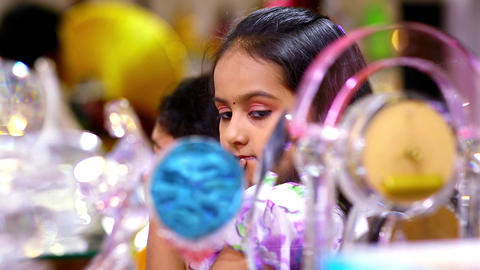 beautiful young girl searching a gift at shopping mall Live Action