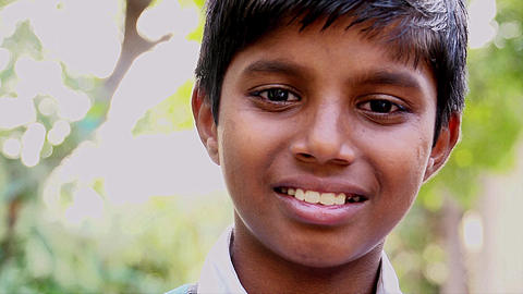 serious Indian boy looking at camera. portrait of serious and emotions kid Footage