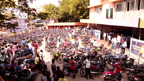 Bike parking at cinema theater, First day movie release peoples waiting in line Live Action