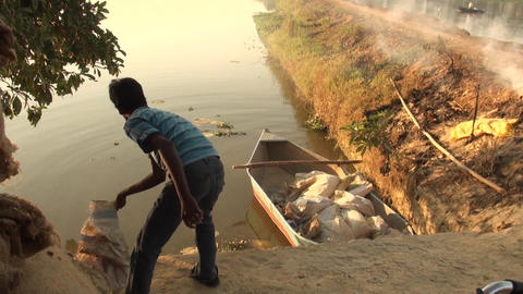 The young fishermen is working early morning. A young man working at early Live Action
