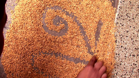 Indian culture, Child writing a letters on paddy seeds in Tamil first words Footage