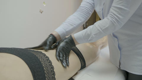 Professional female masseur applying manual anti cellulite massage at beauty spa Footage