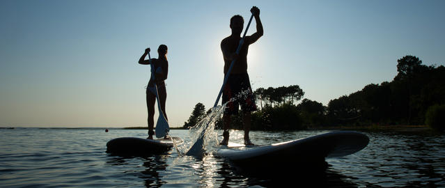 Family Having Fun Stand Up Paddling Together Fotografía