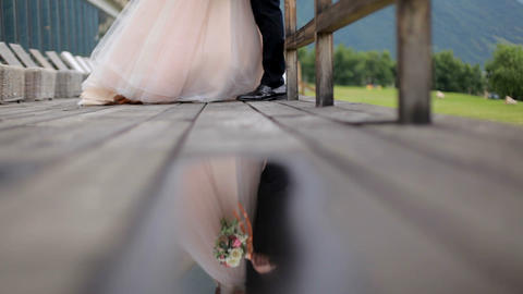Romantic photosession of the newlyweds. Reflection in a puddle. Slow motion Footage