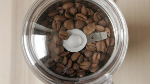 Electric coffee grinder works. High angle view Footage
