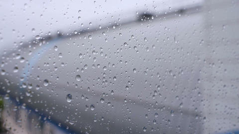 Raindrops flows down on the clear window Footage