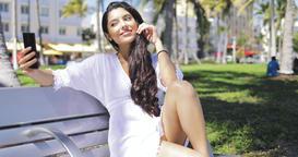Sensual brunette taking selfie in summer park Footage