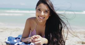Charming brunette in bikini lying on beach Footage