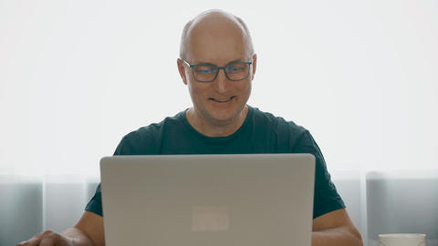 Portrait smiling man using notebook computer and looking into camera Footage