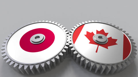 Flags of Japan and Canada on meshing gears. International cooperation conceptual Footage