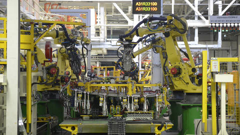 Automobile plant, industrial robots on the automatic assembly line Live Action