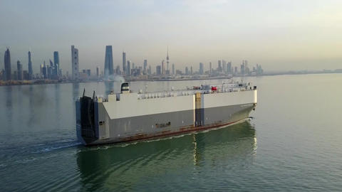 a cargo ship sails near the city of Kuwait Footage