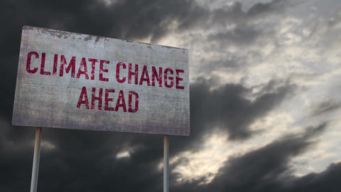 4K Climate Change Ahead Rusty Sign under Clouds Timelapse Animation