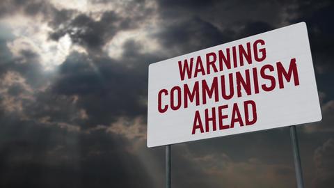 4K Communism Warning Sign under Clouds Timelapse Animation