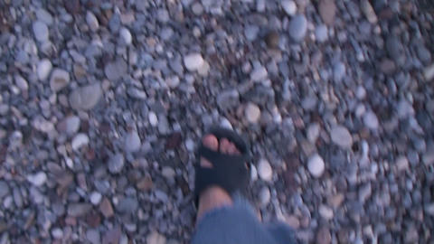 Walking on a shingly beach Footage