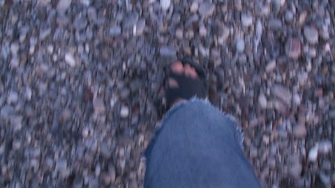 Walking on a shingly beach Stock Video Footage