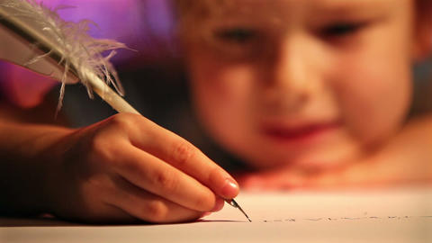 Girl writing with quill pen. Xmas concept Stock Video Footage