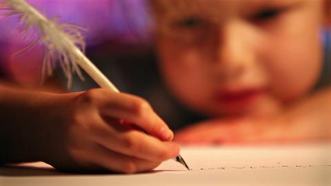 Girl writing with quill pen. Xmas concept Footage