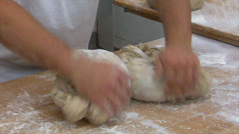german baker kneading two bread slow motion 10831 Stock Video Footage