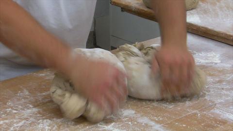german baker kneading two bread slow motion 10831 Stock Video Footage