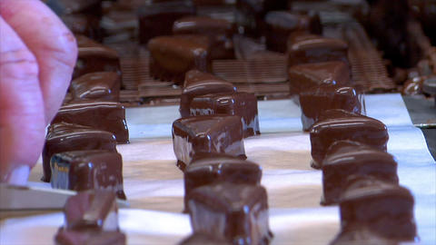 confectioner Baumkuchen triangles conveyor belt long 10837 Stock Video Footage