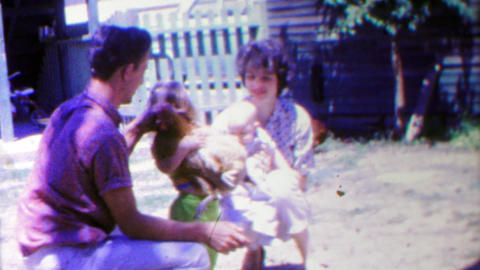 1963: Farm family daughter holding chickens mother caring baby Footage