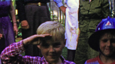 1964: Family BBQ kids clowning soldier marching saluting nationalism Footage