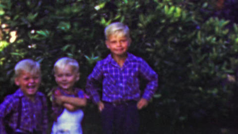 1964: Blonde brothers play outdoor summer blue colorful shirts Footage