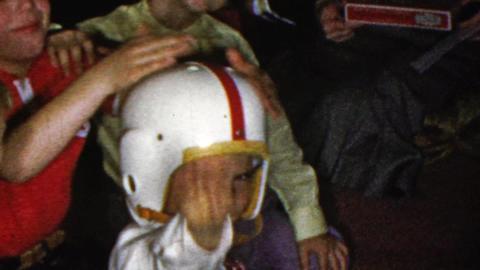 1964: Grade school kid football helmet wave classmates party Footage