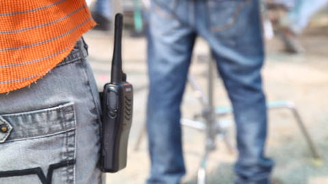 Rear view of Man with walkie talkie Footage