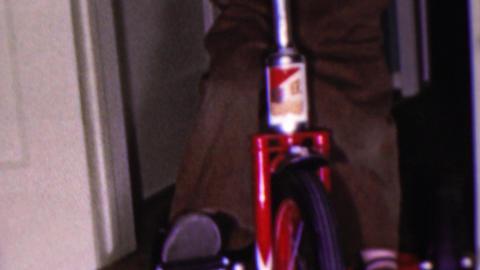 1964: Cute blonde boy rides tricycle bike indoor home holidays Footage