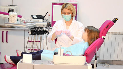 dentist giving an injection to a little girl Footage
