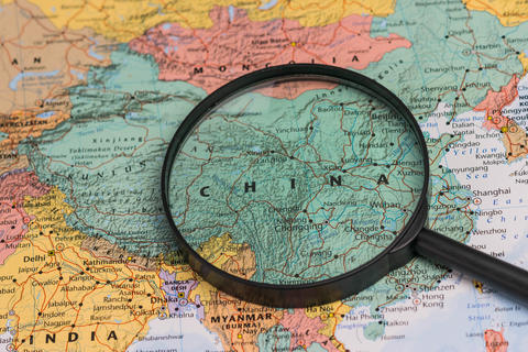 Map of china through magnifying glass on a world map Fotografía