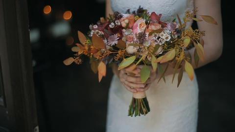 Wedding bouquet in bride hands indoors. Burning candles... Stock Video Footage