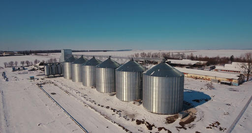 Agriculture grain silos storage tank. Large metal silos elevator and factory Footage