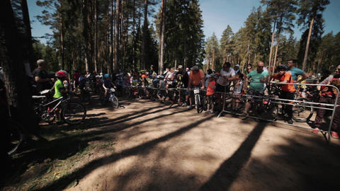 Little children on bicycles participate in race in forest Live Action