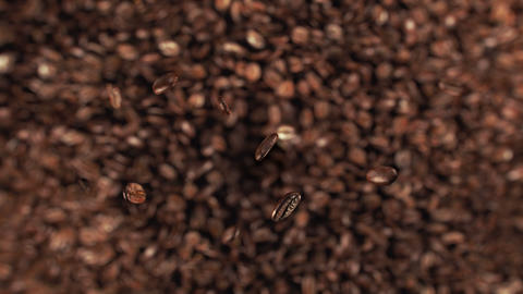 Coffee beans jumping in super slow motion 4K Stock Video Footage