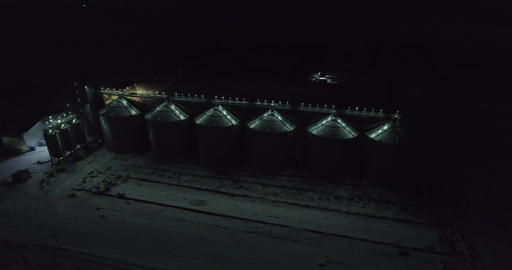 Elevator and factory in Winter night Footage