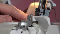 Woman working with sewing machine Footage