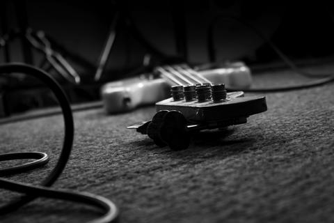 Bass Guitar In Music Studio. Musical Instruments and Equipment Fotografía