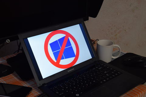 Laptop with the operating system logo displayed on the screen Windows 10 Photo