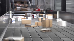 Huge amount of parcels bein transported on conveyor belts with motion blur Footage