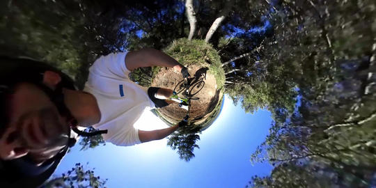 Tiny planet effect of a mountain bike ride on a dirt path in Sardinia, Italy Archivo