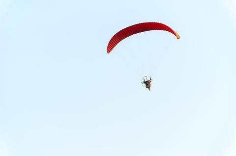 Paratrooper flying in the sky Photo