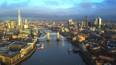4K aerial skyline view of East London at sunrise with Tower Bridge and ビデオ
