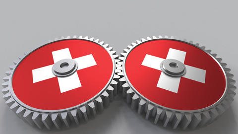 Swiss national project. Flags of Switzerland on moving cogwheels. Conceptual Footage