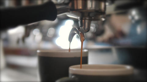 Fresh Black Coffee Pouring from Professional Machine Dispenser in Cups. 4K Footage