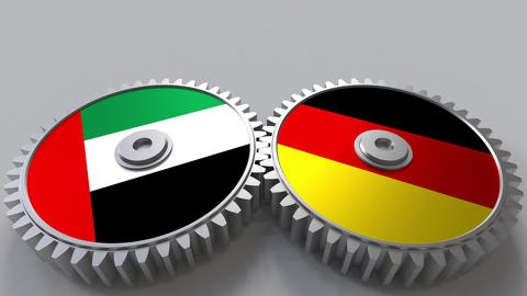 Flags of the UAE and Germany on meshing gears. International cooperation Footage